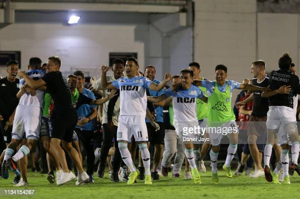 Jonathan Cristaldo Renzo Saravia and Andrés Ríos of Racing Club celebrate with teammates after winning the Superliga 2018/19 against Tigre at Estadio...