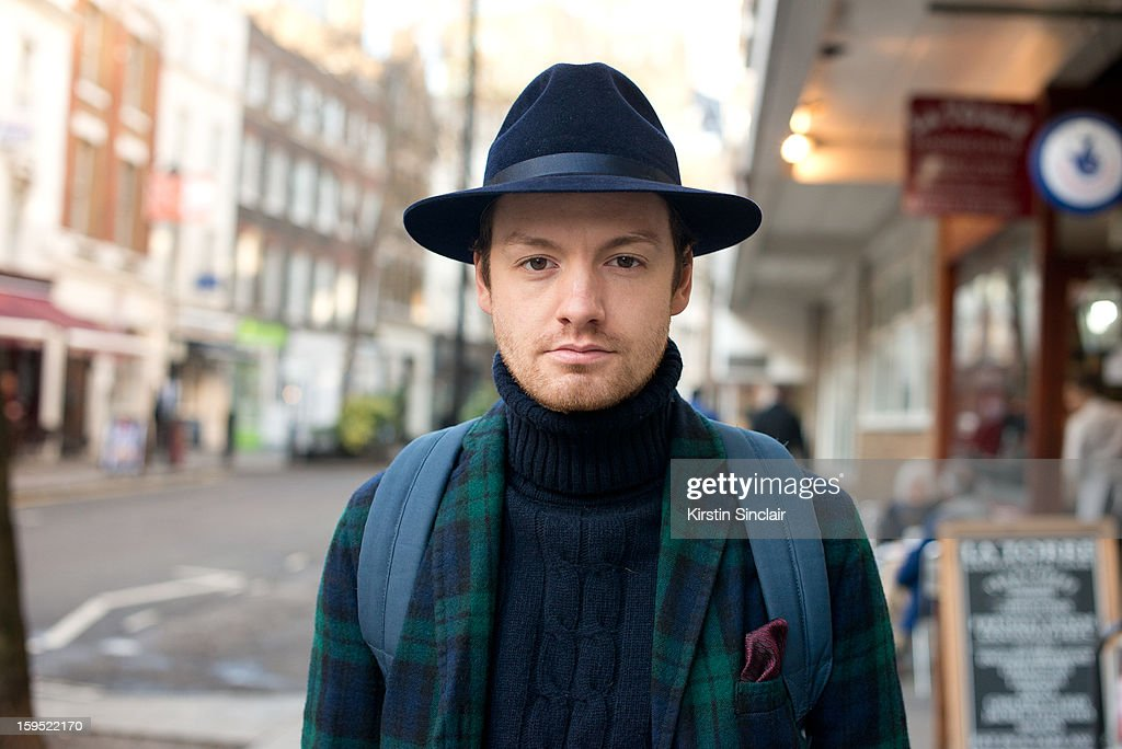 Jonathan Daniel Photographer wearing a Jigsaw suit, Adam Kimmel sweater, Duchamp pocket square and a Laird and Co Hat on day 3 of London Mens Fashion Week Autumn/Winter 2013, on January 09, 2013 in London, England.