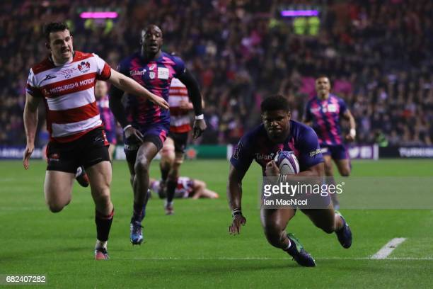 Jonathan Danty of Stade Francais dives over to score his team's second try during the European Rugby Challenge Cup Final between Gloucester and Stade...