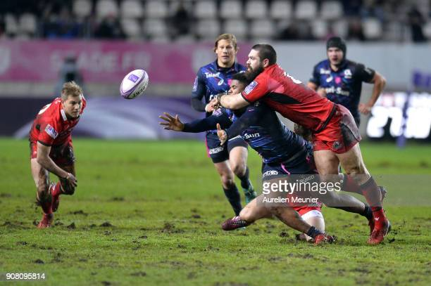 Jonathan Danty of Stade Francais is tackled by Cornell Du Preez of Edinburgh during the European Rugby Challenge Cup match between Stade Francais and...
