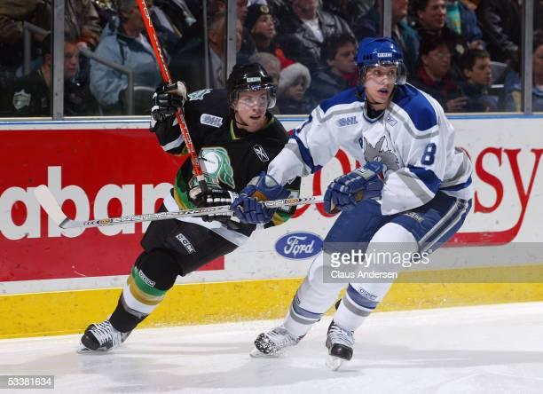 Jonathan D'Aversa of the Sudbury Wolves and Jordan Foreman of the London Knights skate during the Ontario Hockey League game at John Labatt Centre on...