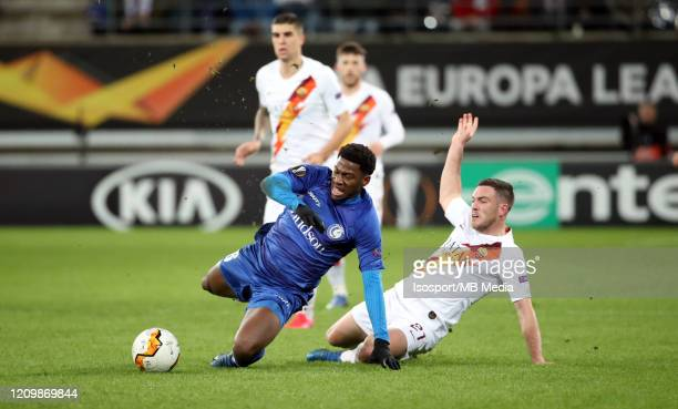Jonathan David of Kaa Gent battles for the ball with Jordan Veretout of AS Roma during the UEFA Europa League round of 32 second leg match between...