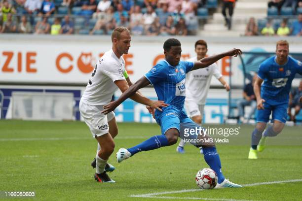 Jonathan David of Kaa Gent fights for the ball with Siebe Blondelle of Kas Eupen and scores a goal during the Jupiler Pro League match between KAA...
