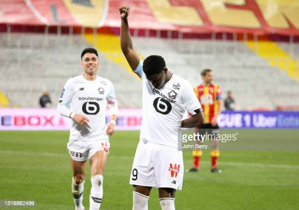 Jonathan David of Lille celebrates his goal with Luiz Araujo during the Ligue 1 match between RC Lens and Lille OSC at Stade Bollaert-Delelis on May...