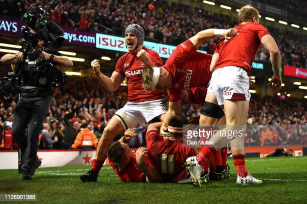 Jonathan Davies celebrates as Josh Adams of Wales scores their second Wales try during the Guinness Six Nations match between Wales and England at...