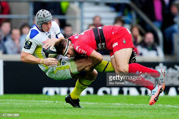 Jonathan Davies of Clermont is tackled by Drew Mitchell of Toulon during the European Rugby Champions Cup Final match between ASM Clermont Auvergne...