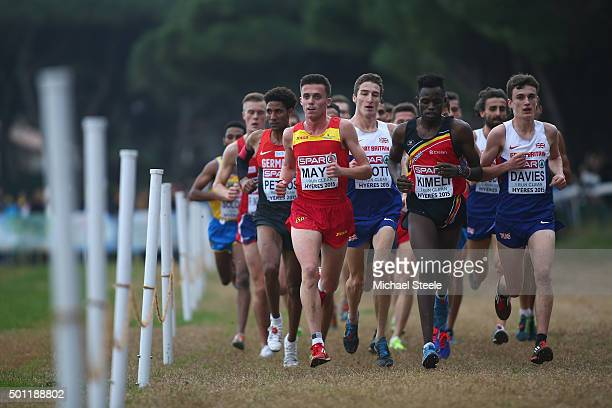 Jonathan Davies of Great Britain eventual winner alongside Isaac Kimeli of Belgium and Carlos Mayo of Spain in the U23 Men's race during the Spar...