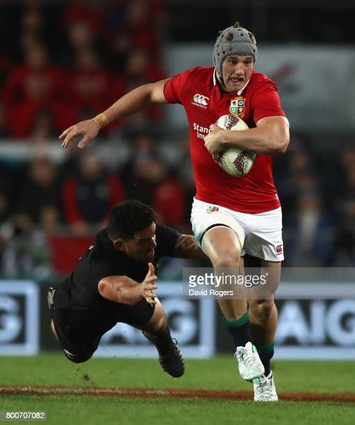 Jonathan Davies of the Lions moves away from Codie Taylor during the Test match between the New Zealand All Blacks and the British Irish Lions at...