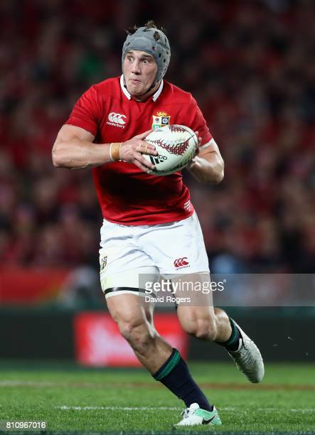 Jonathan Davies of the Lions runs with the ball during the Test match between the New Zealand All Blacks and the British Irish Lions at Eden Park on...