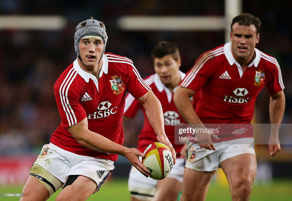 Jonathan Davies (L) of the Lions shapes to pass as Jamie Roberts (R) supports during the match between the NSW Waratahs and the British & Irish Lions at Allianz Stadium on June 15, 2013 in Sydney, Australia.