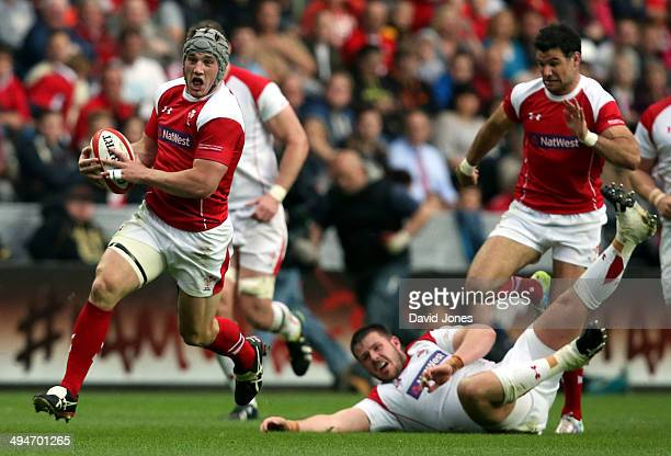 Jonathan Davies of the Probables evades Rob Evans of the Possibles during the Wales Senior Trial between Probables v Possibles at Liberty Stadium on...