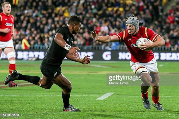 Jonathan Davies of Wales breaks through the tackle of Seta Tamanivalu of the All Blacks to score a try during the International Test match between...