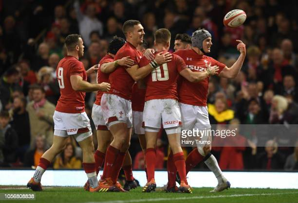 Jonathan Davies of Wales celebrates with team mates after scoring his team's third try of the game during the International Friendly match between...