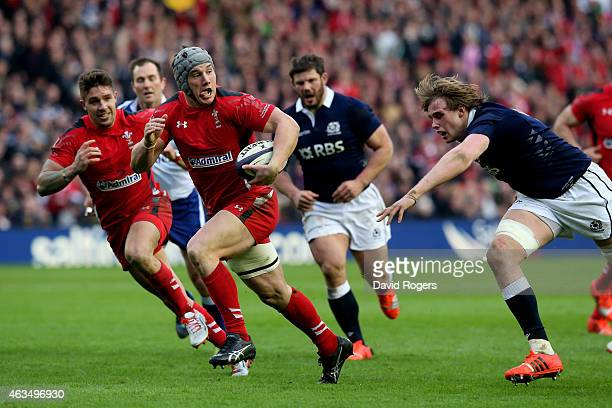Jonathan Davies of Wales goes past Richie Gray of Scotland to score his team's second try during the RBS Six Nations match between Scotland and Wales...