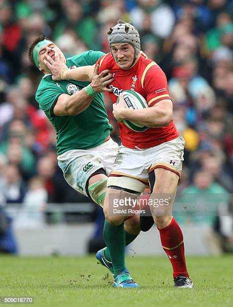 Jonathan Davies of Wales hands off CJ Stander during the RBS Six Nations match between Ireland and Wales at the Aviva Stadium on February 7 2016 in...