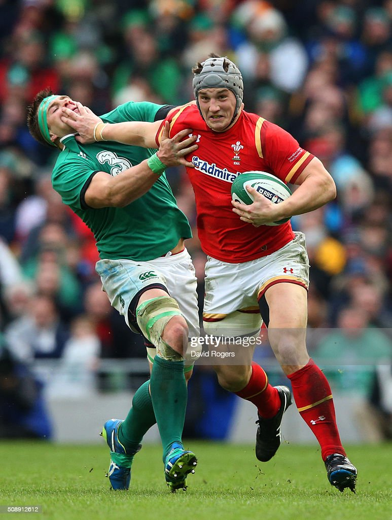Jonathan Davies of Wales hands off CJ Stander of Ireland during the RBS Six Nations match between Ireland and Wales at the Aviva Stadium on February 7, 2016 in Dublin, Ireland.