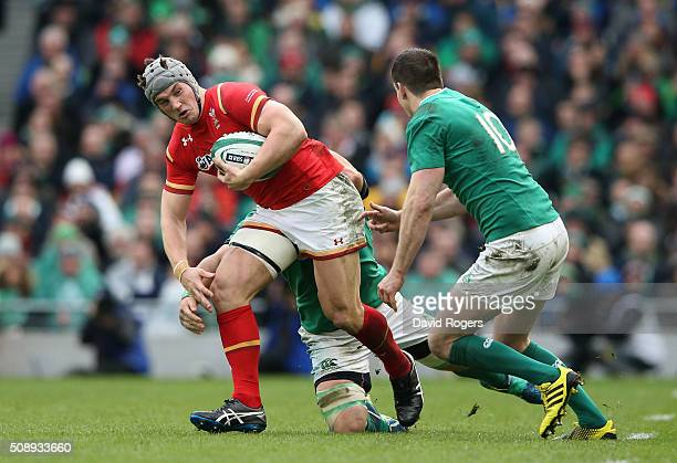 Jonathan Davies of Wales is challenged by Jonathan Sexton of Ireland during the RBS Six Nations match between Ireland and Wales at the Aviva Stadium...