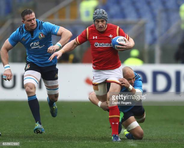 Jonathan Davies of Wales is haukled down by Sergio Parisse of Italy during the RBS Six Nations match between Italy and Wales at the Stadio Olimpico...