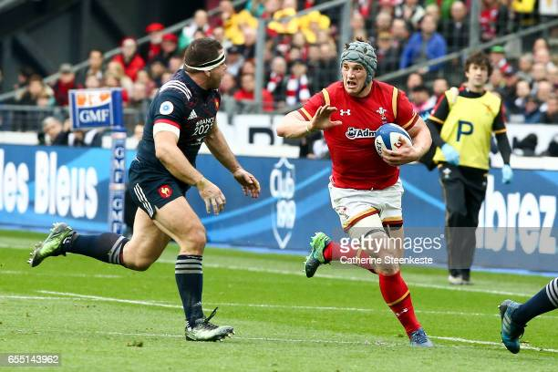 Jonathan Davies of Wales is running with the ball against Guilhem Guirado of France during the RBS Six Nations match between France and Wales at...