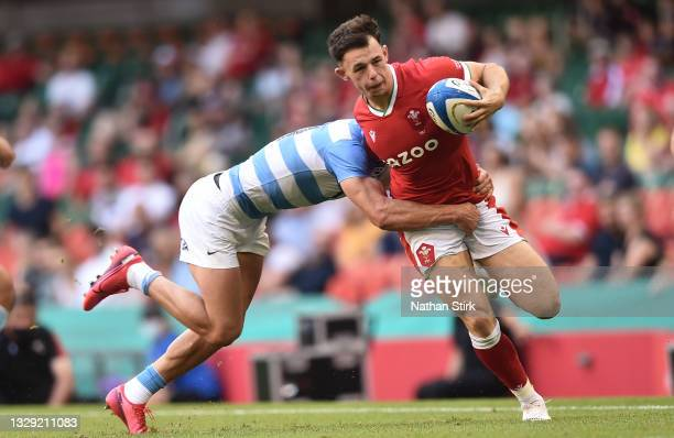 Jonathan Davies of Wales is tackled by Bautista Delguy of Argentina during the International Match between Wales and Argentina at Principality...