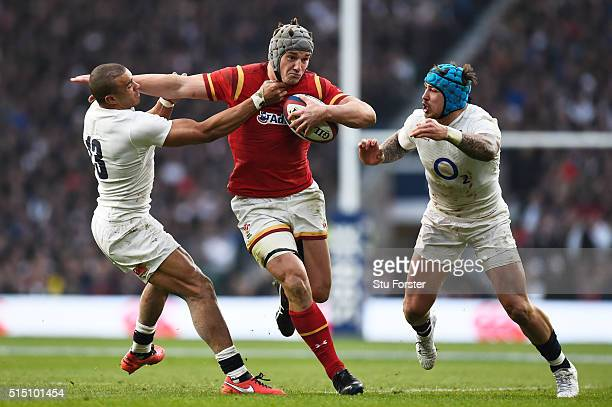 Jonathan Davies of Wales is tackled by Jonathan Joseph and Jack Nowell of England during the RBS Six Nations match between England and Wales at...