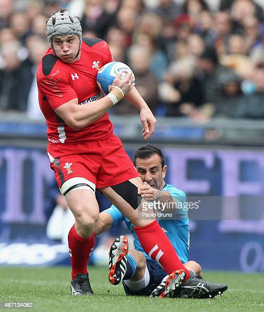 Jonathan Davies of Wales is tackled by Luciano Orquera of Italy during the RBS Six Nations match between Italy and Wales at Stadio Olimpico on March...
