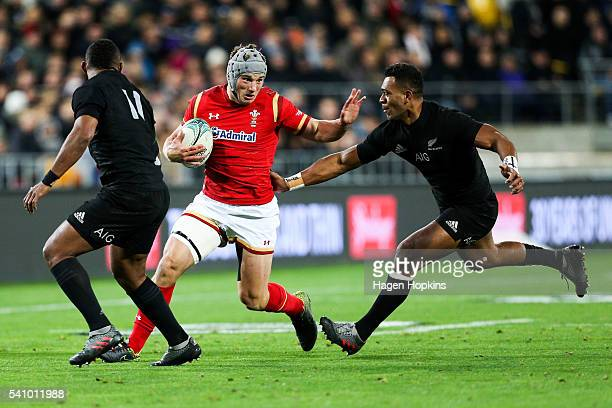 Jonathan Davies of Wales is tackled by Waisake Naholo and Seta Tamanivalu of the All Blacks during the International Test match between the New...