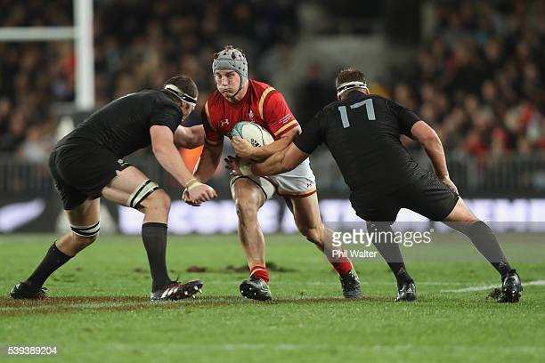 Jonathan Davies of Wales is tackled during the International Test match between the New Zealand All Blacks and Wales at Eden Park on June 11 2016 in...