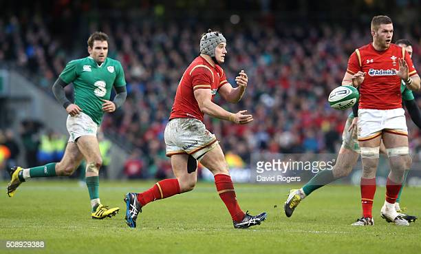 Jonathan Davies of Wales passes the ball during the RBS Six Nations match between Ireland and Wales at the Aviva Stadium on February 7 2016 in Dublin...