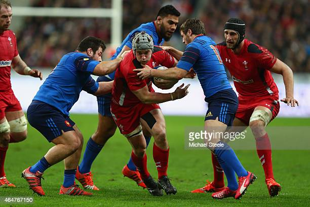 Jonathan Davies of Wales powers his way past Guilhem Guirado and Camlle Lopez of France during the RBS Six Nations match between France and Wales at...