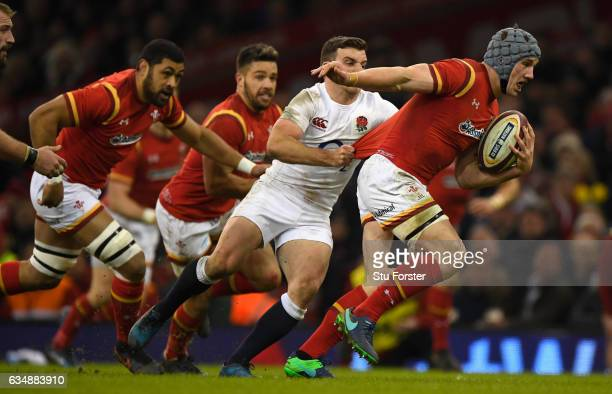 Jonathan Davies of Wales pulls away from George Ford during the RBS Six Nations match between Wales and England at Principality Stadium on February...