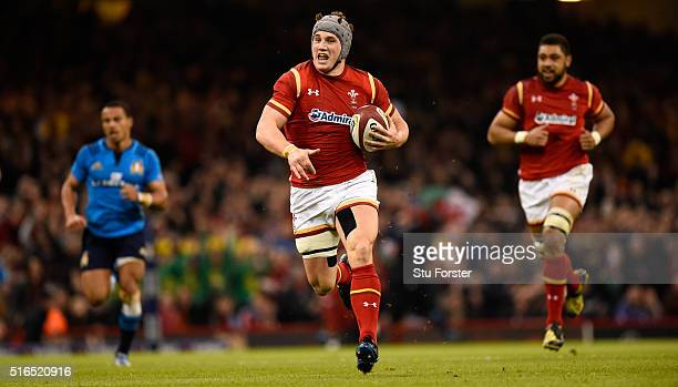 Jonathan Davies of Wales races away to score during the RBS Six Nations match between Wales and Italy at the Principality Stadium on March 19 2016 in...