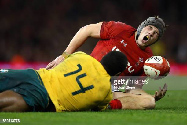 Jonathan Davies of Wales reacts to being tackled by Marika Koroibete of Australia and is later stretched off injured during the Under Armour Series...