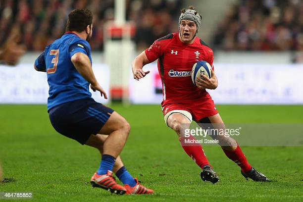 Jonathan Davies of Wales runs at Rabah Slimani of France during the RBS Six Nations match between France and Wales at the Stade de France on February...