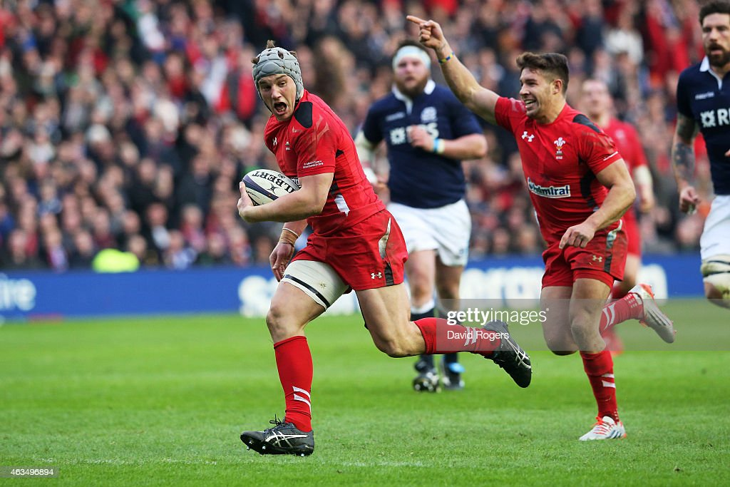 Jonathan Davies of Wales scores his team's second try as teammates Rhys Webb of Wales celebrates during the RBS Six Nations match between Scotland and Wales at Murrayfield Stadium on February 15, 2015 in Edinburgh, Scotland.