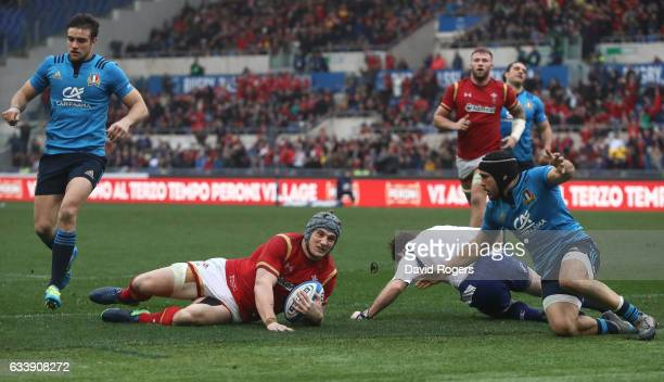 Jonathan Davies of Wales slides over to score his team's first try during the RBS Six Nations match between Italy and Wales at the Stadio Olimpico on...