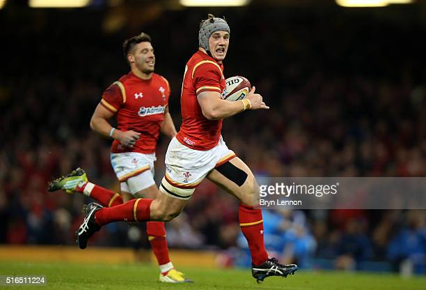 Jonathan Davies of Wales sprints clear to score his team's third try during the RBS Six Nations match between Wales and Italy at the Principality...