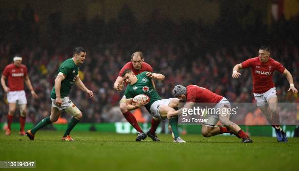 Jonathan Davies of Wales tackles Garry Ringrose of Ireland during the Guinness Six Nations match between Wales and Ireland at Principality Stadium on...