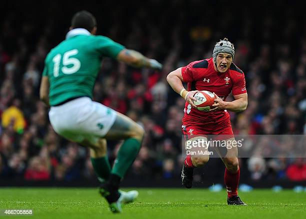 Jonathan Davies of Wales takes on Rob Kearney of Ireland during the RBS Six Nations match between Wales and Ireland at Millennium Stadium on March 14...