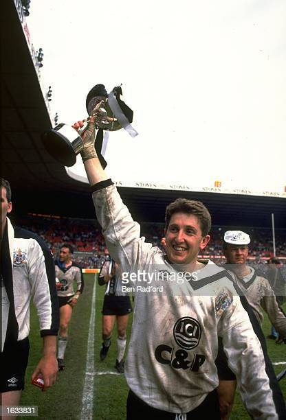 Jonathan Davies of Widnes lifts the trophy aloft after their victory over Hull in the Premiership final at Old Trafford in Manchester, England....