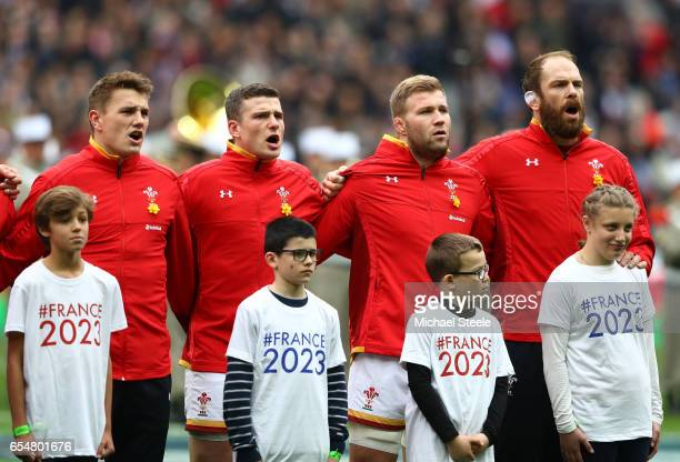 Jonathan Davies Scott Williams Ross Moriarty and Alun Wyn Jones of Wales sing their national anthem prior to kickoff during the RBS Six Nations match...