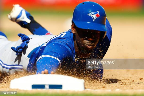 Jonathan Davis of the Toronto Blue Jays dives into first base on a pick off attempt in the sixth inning against the New York Yankees at Yankee...