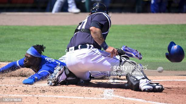 Jonathan Davis of the Toronto Blue Jays slides safely into home plate on a sacrifice fly ball from Rowdy Tellez as Wilson Ramos of the Detroit Tigers...