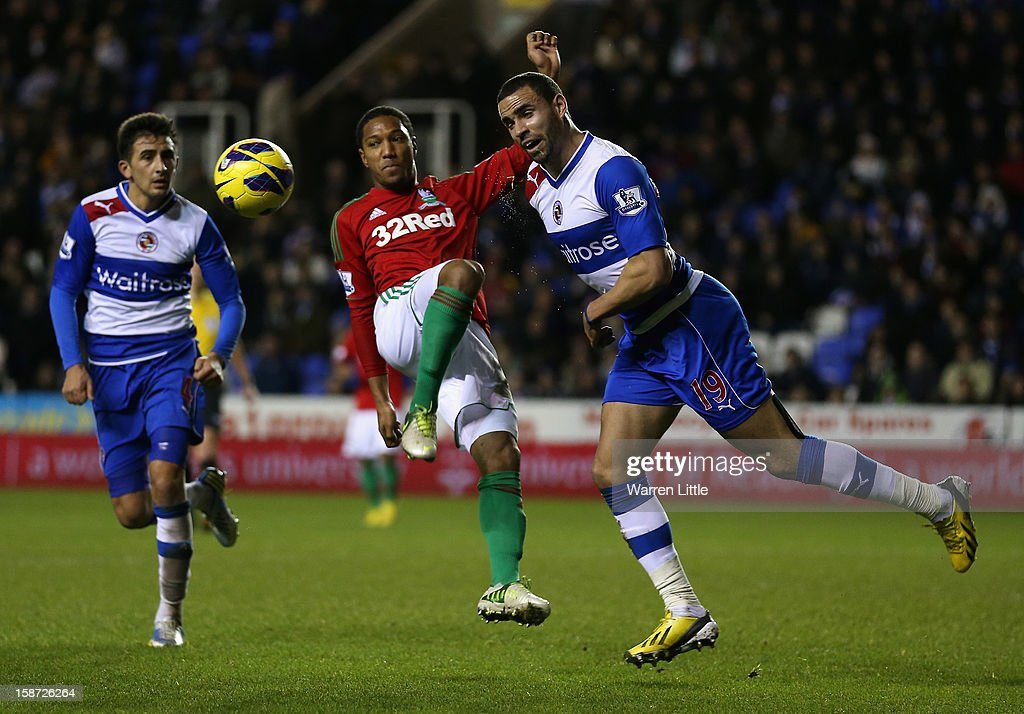 Jonathan De Guzaman of Swansea challenges Hal Robson-Kanu during the Barclays Premier League match between Reading and Swansea City at Madejski Stadium on December 26, 2012 in Reading, England.