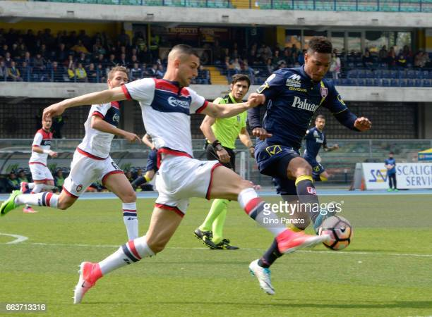 Jonathan De Guzman of Chievo Verona competes with Aleandro Rosi of Crotone during the Serie A match between AC ChievoVerona and FC Crotone at Stadio...