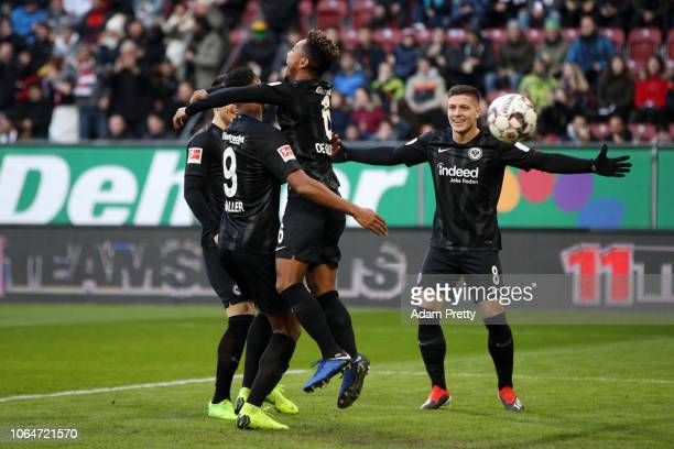 Jonathan De Guzman of Eintracht Frankfurt celebrates with teammates after scoring his team's first goal during the Bundesliga match between FC...