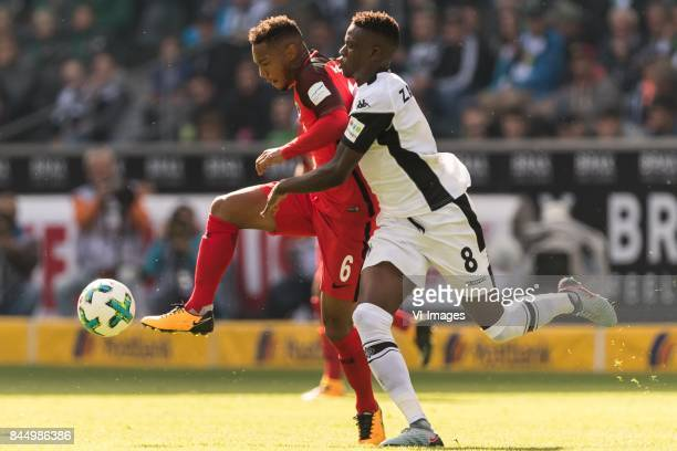 Jonathan de Guzman of Eintracht Frankfurt Denis Zakaria Lako Lado of Borussia Monchengladbach during the Bundesliga match between Borussia...