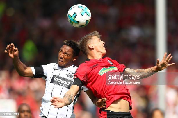 Jonathan de Guzman of Frankfurt and Mike Frantz of FC Freiburg during the Bundesliga match between SportClub Freiburg and Eintracht Frankfurt at...