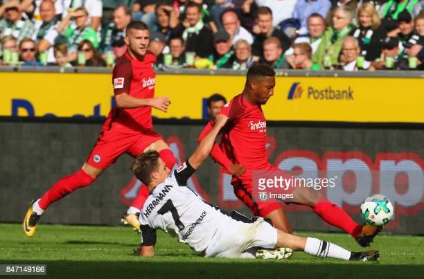 Jonathan de Guzman of Frankfurt and Patrick Herrmann of Moenchengladbach battle for the ball during the Bundesliga match between Borussia...