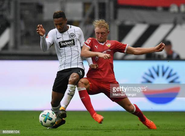Jonathan de Guzman of Frankfurt is challenged by Andreas Beck of Stuttgart during the Bundesliga match between Eintracht Frankfurt and VfB Stuttgart...